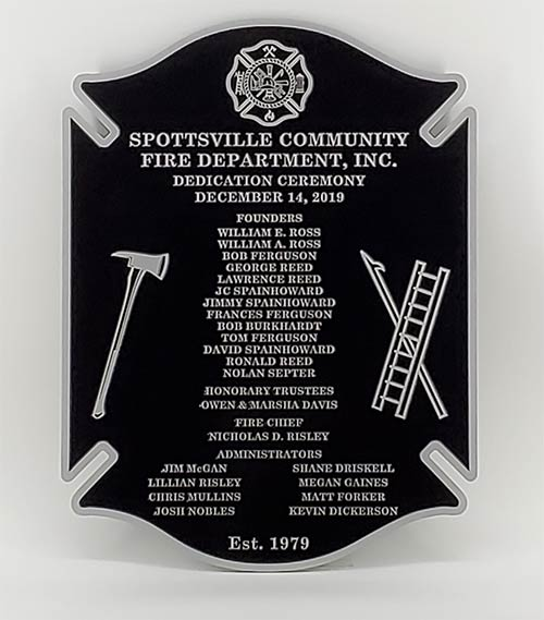 A aluminum plaque that was created for a Fire Department dedication ceremony